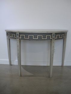 Circa 1830 Pair of Painted French Demi-Lune Consoles With Greek-Key Motif | From a unique collection of antique and modern console tables at https://www.1stdibs.com/furniture/tables/console-tables/