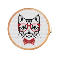 Hipster Cat - Cross stitch pattern. Floss: DMC Canvas: Aida 14 Grid Size: 59W x 78H Design Area: 4,21 x 5,43 (59 x 76 stitches) Number of colors: 5 Use 2 strands of thread for cross stitch. ONLY PATTERN! This PDF file counted cross stitch pattern is available for instant download. This PDF pattern Included: - Color image of the finished design - Color Block Chart - Color Floss Legend with DMC stranded cotton. In order to open these files you will need Adobe Reader, ...