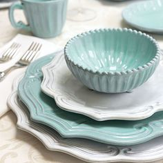 The new Vietri Incanto Aqua Baroque Italian dinnerware collection is handmade of terra marrone clay in a rich aqua color. The Incanto Baroque and Stripe shapes all dressed up in the crisp, fresh aqua blue makes quite a statement on any tabletop. Table Turquoise, Light Turquoise, Tables Tableaux, Kitchen Dining, Kitchen Decor, Dining Room, Aqua Kitchen, Dining Ware, Turquoise Kitchen