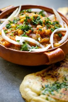 chana masala and garlic naan ~ the naan recipe looks like a good one!