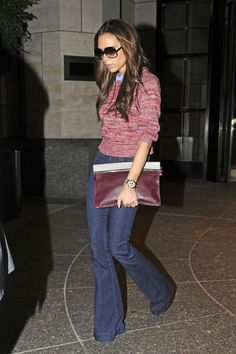 fun color sweater, collar shirt, wide leg jeans, heels, and big clutch