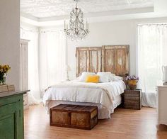 Add architectural detail to your bedroom by replacing an ordinary headboard with rustic barn doors.