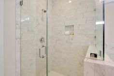 Large walk-in shower with granite subway tiles.