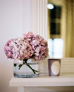 Details Photo - A vase of pink flowers atop a white mantel