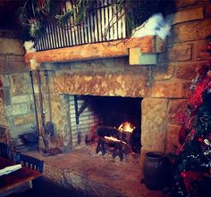 My daddy designed and built this beautiful fireplace out of 7 old chimneys. This beauty is the centerpiece of our family restaurant, http//www.adamsbreezyhillfarm.com