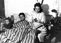 "Nurse Janina Stęczniewska (code name ""Inka"") with her daughter Hania and wounded…"
