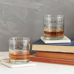 Sip in Founding Fathers style with one of these elegantly geeky rocks glasses. Printed with script from either the US Constitution or Declaration of Independence, they pay tribute to the foundation of American government... and a stiff drink. Give one to a beloved history buff, teacher, or champion of the American Dream. Made in Virginville, Pennsylvania. Make it a collection with the Democracy Coasters - Set of 4.