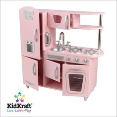 """Vintage Kitchen Pink by KidKraft. $179.04. Doors open and close. Height 35.7"""". Length 33"""". Width 13"""". Oven knobs click and turn. Bon Appétit! Our Vintage Kitchen lets kids pretend they are cooking big feasts for the whole family. With its close attention to detail and interactive features, this adorable kitchen would make a great gift for any of the young chefs in your life.33"""" L x 13"""" W x 35.7"""" HAge 3-8Material MDFStyle/Theme Traditional"""