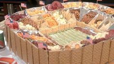 Build a stadium filled with chips, dips, cheeses and snacks simply by folding aluminum foil