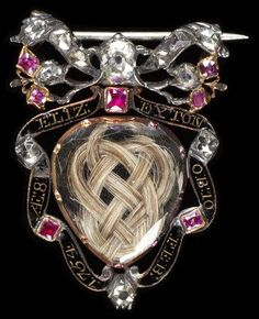 Mourning Brooch 1754. Silver openwork set with rose and brilliant-cut diamonds and rubies, and enamelled gold with hair. V