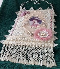 Fabric and lace wall hanging