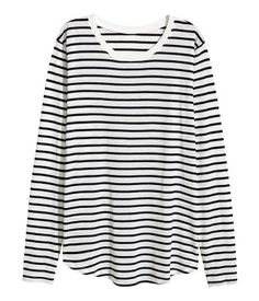 White/black striped. Long-sleeved top in soft jersey with narrow ribbing at neckline and a gently rounded hem.