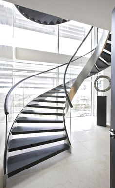 modern stairs design ideas ideas stunning modern staircase design for homes with black wooden staircase mounted on the chrome metal stairs frame and clear glass fence also black metal Modern Stair Railing, Staircase Railings, Curved Staircase, Modern Stairs, Railing Design, Staircase Design, Stair Design, Staircase Ideas, Stairways