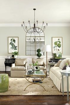 This neutral living room is accented with greens