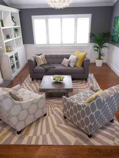 gray & yellow living room - love the couch and chairs, navy or coral instead of yellow?