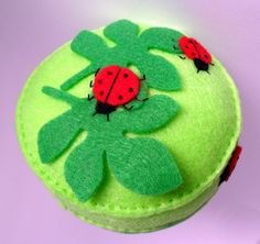 Ladybugs on leaves Pincushion by Spincushions, via Flickr