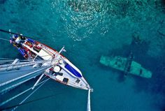 https://flic.kr/p/jzKWdC | airplane from masthead | View from atop the mast of the private yacht Freydis as it passes by a sunken three-seat Japanese float plane from WW2, said to have been sunk by American aircraft while anchored in the Shortland group of the Solomon Islands. This picture was taken on a six-week trip by private sailboat through the seldom-visited islands north of New Guinea, in an area of the South Pacific known as the Solomon Sea. Most of the islets here have no airport or…