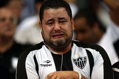 OVERCOME WITH EMOTION: A fan of Brazil's Atletico Mineiro soccer club cried as his team beat Paraguay's Olimpia club, 4-3 in a penalty shootout, Wednesday in Belo Horizonte, Brazil, winning its first Libertadores title. (Fernando Bizerra Jr./European Pressphoto Agency)