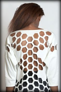 Sweatshirt made from thick ponti fabric with laser cut hexagons throughout the hem!