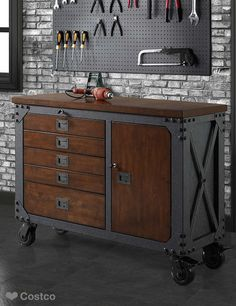 This sturdy, industrial-style inspired rolling workbench is the ideal blend of rugged powder-coat steel with a solid wood-top. A rich hand-applied finish sets off this workbench, offers handsome practicality to your work shop, garage or any creative work space you can imagine.