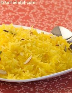 Try this simple version of the popular meetha chawal. You do not need to prepare any syrup for this version of sweet rice, as the rice and sugar are cooked together. With the addition of saffron, cinnamon, cloves and bayleaves, a sweet, spicy aroma fills the whole house kindling everybody's appetite!