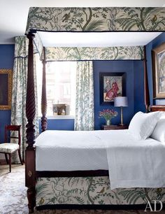 the curtain and canopy fabric is by Brunschwig & Fils, and the walls are covered in a Fromental silk wallpaper.