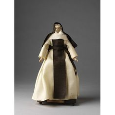 Trappist Nun; Trappistine    Object:  Ecclesiastical figure    Place of origin:  France (possibly, made)   germany (possibly, made)   Netherlands (possibly, made)    Date:  18th century (made)    Artist/Maker:  Unknown (production)    Materials and Techniques:  Figure made of tow and wax, dressed in linen and woollen materials.    Credit Line:  Given by Mr. G. Smith    Museum number:  1212:31-1905    Gallery location:  In Storage