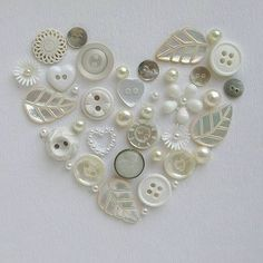 c Cute idea. Use old buttons to create a heart shape like this, top it off with a shadow box frame to finish the look, and you have homemade art! This would be cute in a star with colored buttons. Button Art, Button Crafts, Heart Button, Diy And Crafts, Arts And Crafts, Paper Crafts, Beach Crafts, Summer Crafts, Creation Deco