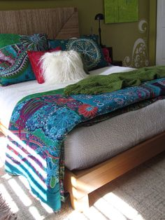 I love the colours and design in the bedspread and pillows! #Boho bedroom