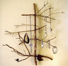 Necklace stand made out of stained branches.