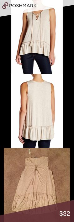 Max Studio Hi-Lo Tank A ruffled hi-lo hem flatters your curves in a jersey knit top, styled with tassels at the neckline. Lace-up neck, sleeveless, hi-lo hem. 95% rayon, 5% spandex. Machine wash cold. Max Studio Tops Tank Tops
