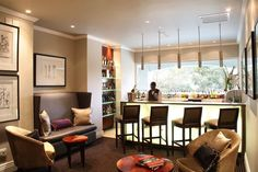 Sophisticated, glamorous interior design and decoration of a boutique hotel in Johannesburg.  Elegant bar area.