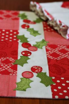 Holly and Patchwork Runner/Placemat. I would love this on my table during the Holidays. Christmas Sewing, Christmas Projects, Holiday Crafts, Christmas Quilting, Christmas Placemats, Christmas Runner, Christmas Patterns, Christmas Tea, Table Runner And Placemats