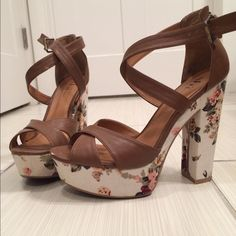Shi floral strappy heels I love these shoes! Tan leather material, floral bottom portion of shoe. 5 inches high. In good condition. There is a little wear and tear on the leather part and a discoloration on the floral part of the heels, but you can't tell unless you look closely. The buckles are discolored as well (again it's hard to tell in person). I have worn these a handful of times, but I don't like being taller than my husband, so I'm selling them :) Shi Shoes Heels