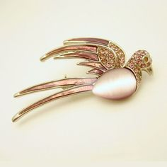 SWEET! Lovely vintage bird brooch with pink/purple enamel, pink rhinestones, pink satin glass belly stone. $39.95 From https://www.etsy.com/shop/MyClassicJewelry #myclassicjewelry #vintagebrooch #birdbrooch #rhinestonebrooch