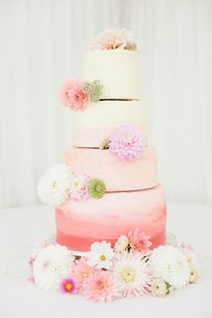 Four tier wedding cake in shades of pink. Photography by James Allan.