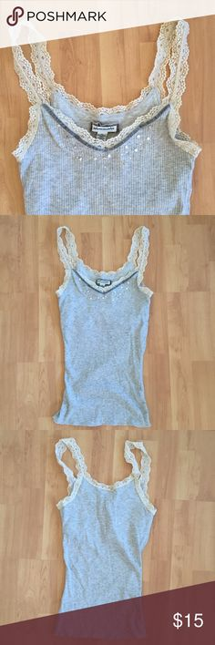 Abercrombie embellished tank top Abercrombie kids XL tank top with lace straps and embellished neckline. It also has a shelf bra. Worn only once and in perfect condition.  Marked as a women's size small, but is actually kids XL. Abercrombie & Fitch Tops Tank Tops