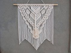 Macrame wall hanging Color: off-white. Material: unbleached cotton rope, wood. Length of the wood is approx 90 cm (35.5 inches); macrame canvas is approx max 93 cm (36.5 inches) long. More macrame wall hangings https://www.etsy.com/shop/PapuShoi?section_id=19482238 If you have any