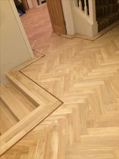 Oak parquet completely laid with a walnut tramline.