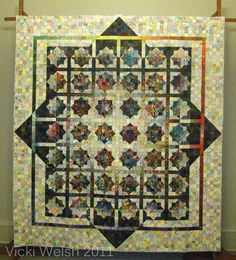 This one is really neat. According to the description, the squares were originally intended for a watercolour quilt but their owner realized that she didn't enjoy using that technique. She gave them to a friend who made this quilt.
