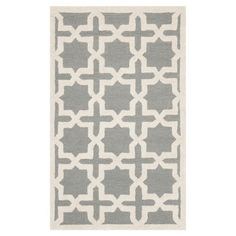 Showcasing a silver Moroccan-inspired trellis motif, this hand-tufted wool rug brings a pop of pattern to your dining room or den.   Pro...