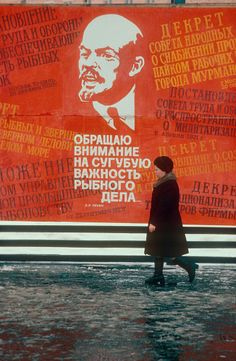 Woman walking past a large Soviet Poster depicting Lenin. Siberia. Russia. 1984: Russia, Moscow: Arctic & Antarctic photographs, pictures & images from Bryan & Cherry Alexander Photography.