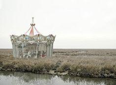Abandoned carousel ~ quite odd...