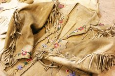 What a beauty.  I bought a vintage dark brown suede fringed jacket a couple of months ago.  This one looks hand-painted and the colors are gorgeous.