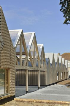A long run of gabled volumes clad in honey-coloured timber has been designed by Tracks Architectes for a kindergarten called La Ruche, or The Beehive. Timber Architecture, School Architecture, Architecture Design, Timber Structure, Cladding, Layout, Exterior, House Styles, Building