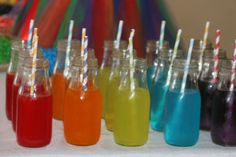 Care Bear Party Coloured drinks and party table setting (white table cloth and streamer rainbow