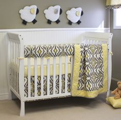 This modern gray and yellow bumper-less crib bedding from @sweetkylababy also features adorable matching decor! #PNpartner