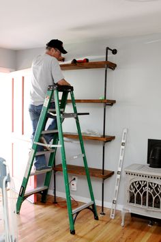 industrial shelving DIY. to match my wood and pipe entry table!