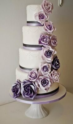 Cascading purple flowers down your wedding cake makes a beautiful and sophisticated statement.  #UltraViolet #WeddingCake