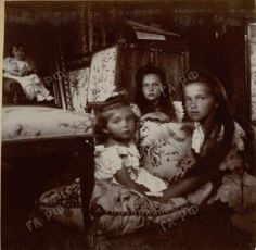 Rare photo of Alexei with Tatiana and Olga, c. 1906. A framed picture of Alexei can be seen in the top left-hand corner.